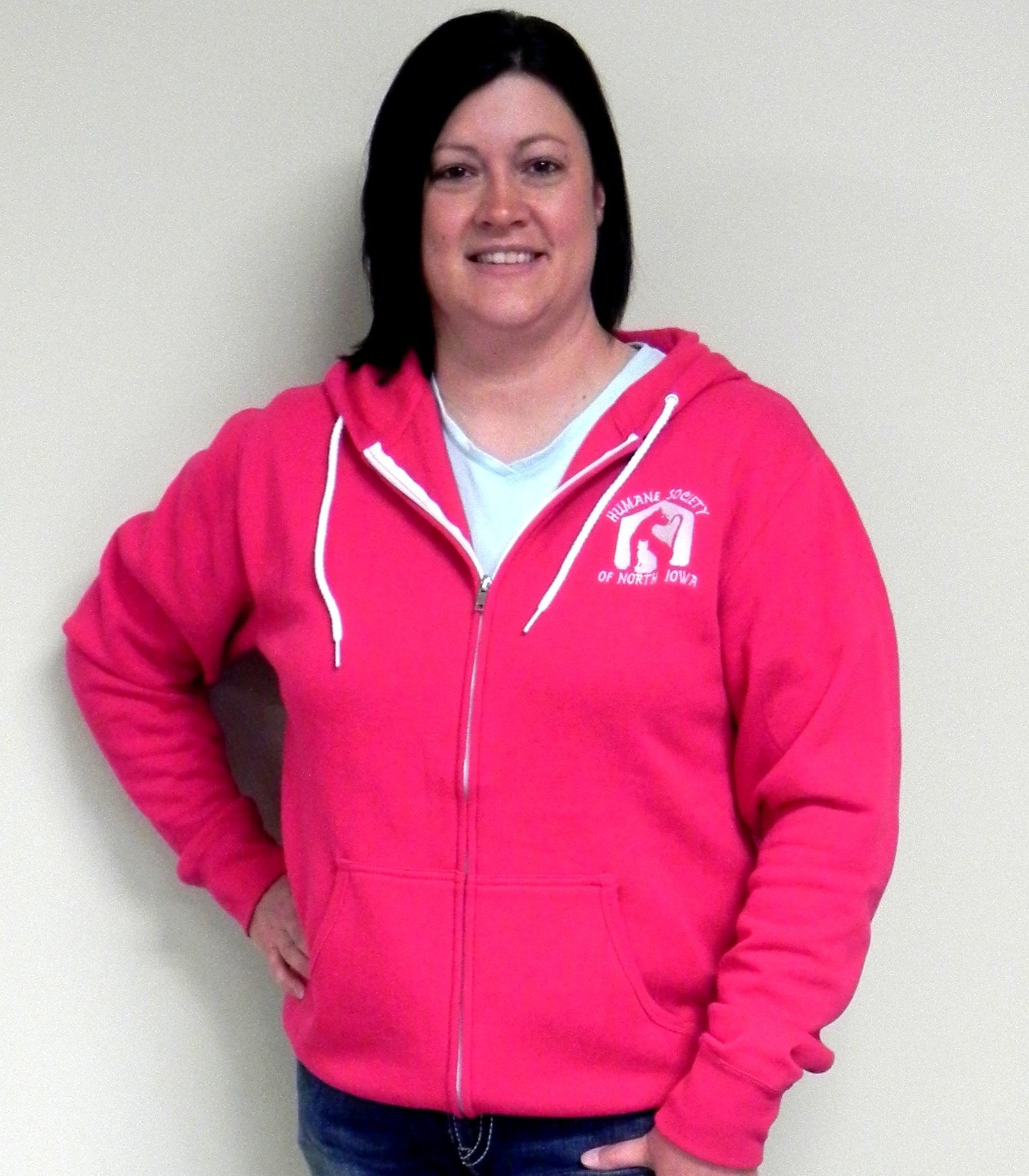 Humane Society of North Iowa Board President Stacy Rooney models our new zip-up hoodie